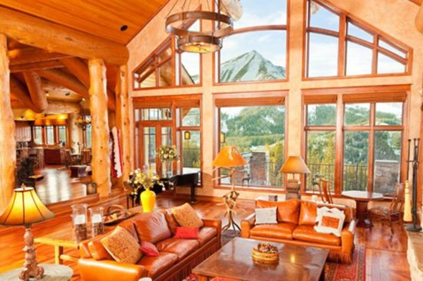 wooden log interior of yellowstone club private home residence in blue sky montana
