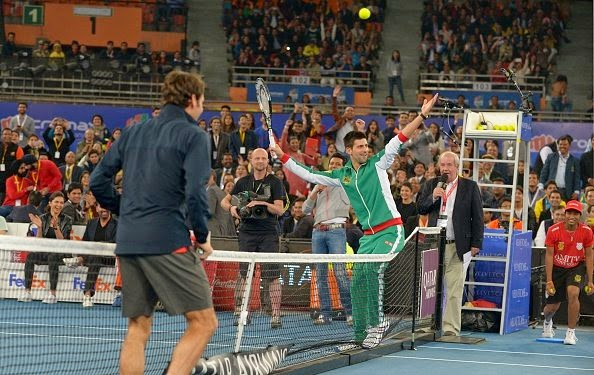 Roger Federer and Novak Djokovic enjoy a game of tennis with Bollywood actors