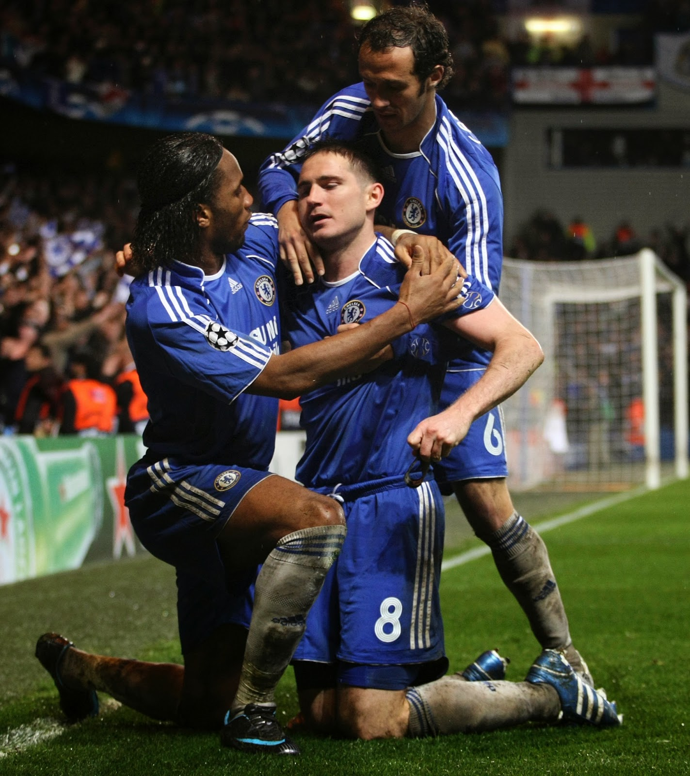 A photograph of Frank Lampard, Didier Drogba and Carvalho celebrating Lampard scoring a goal