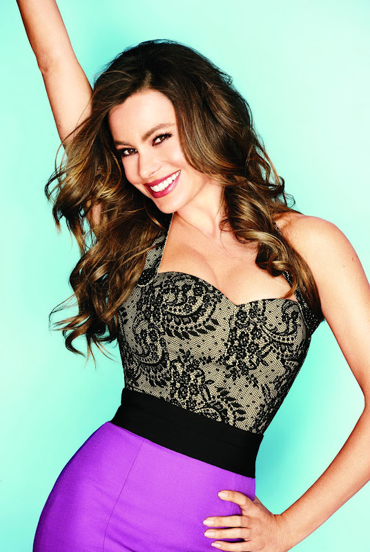 Sofia Vergara strikes a pose in a purple skirt and a hot top for Lucky Magazine November 2012