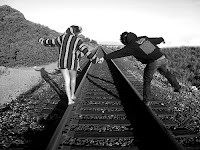 Boy And Girl On Rail Tracks- black and white image