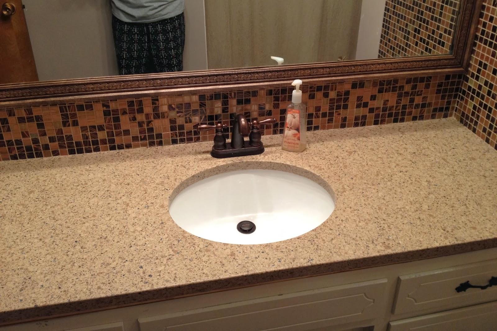 DIY Why Spend More: Decorative trim on bathroom mirror