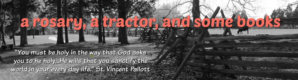 a rosary, a tractor, and some books