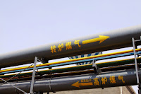 Chinese coal plant pipes (Credit: Shutterstock) Click to Enlarge.