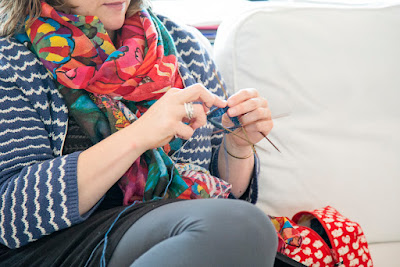 Photo of Sarah knitting by Shan Leigh