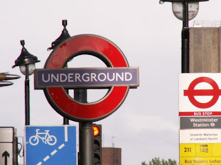 sign for the london underground and bus