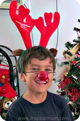 Leaving a carrot out for the reindeer - boy dressed as a reindeer for Christmas