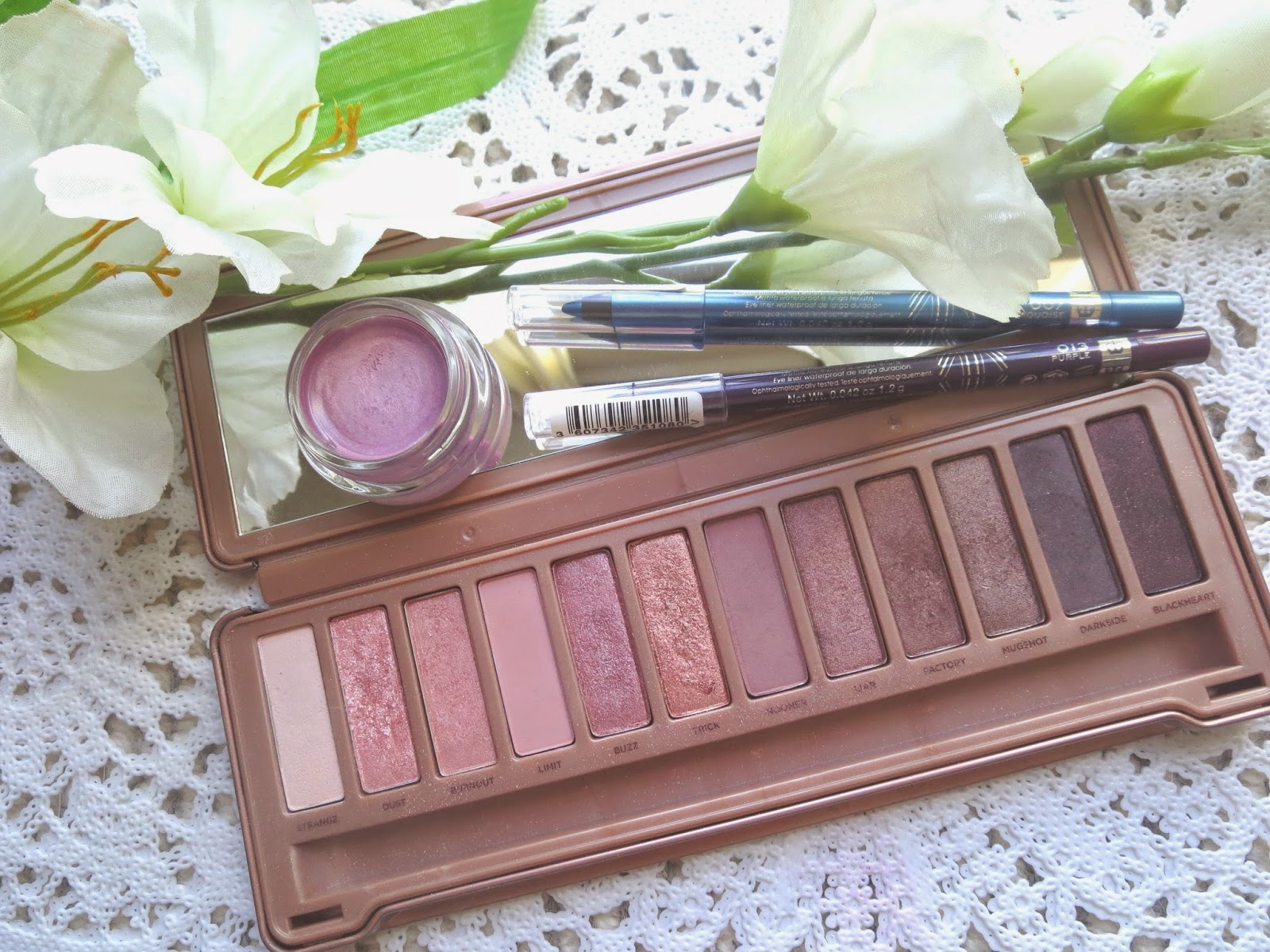 a picture of spring favorites for eyes ; maybelline color tattoo Hibiscus Heartbreaker, Naked 3 palette, Rimmel Scandaleyes Kohl purple, turquoise