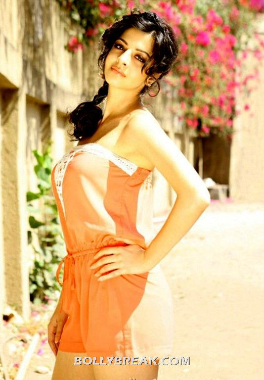 Vedhika in an orange strapless romper - Vedhika unseen latest pics- HOT!