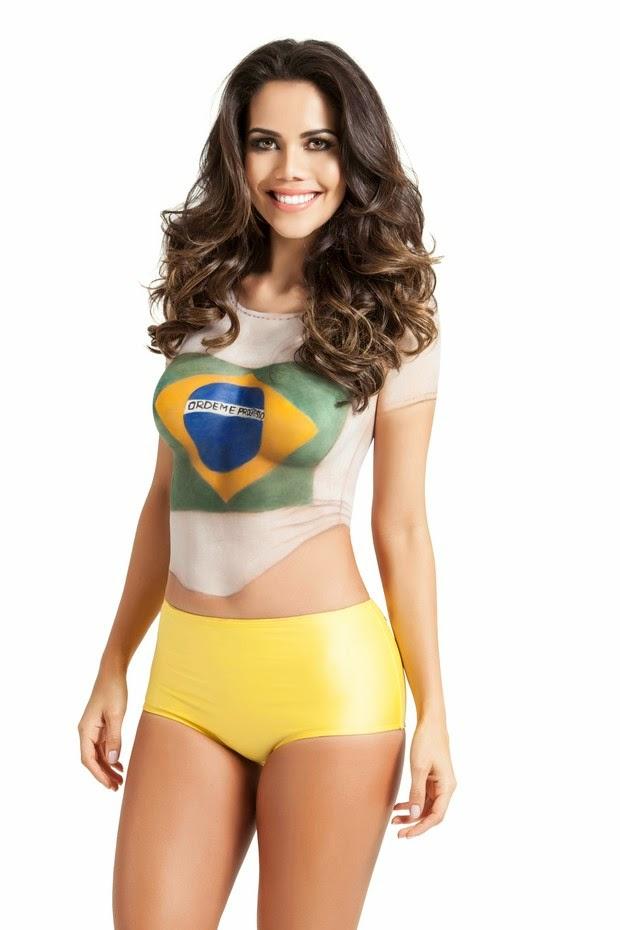 Daniela Albuquerque pinta o corpo para reforçar a torcida pelo Brasil