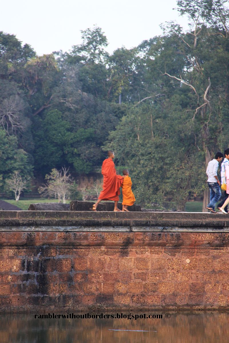 Monk at the causeway of Angkor Wat, Sien Reap, Cambodia