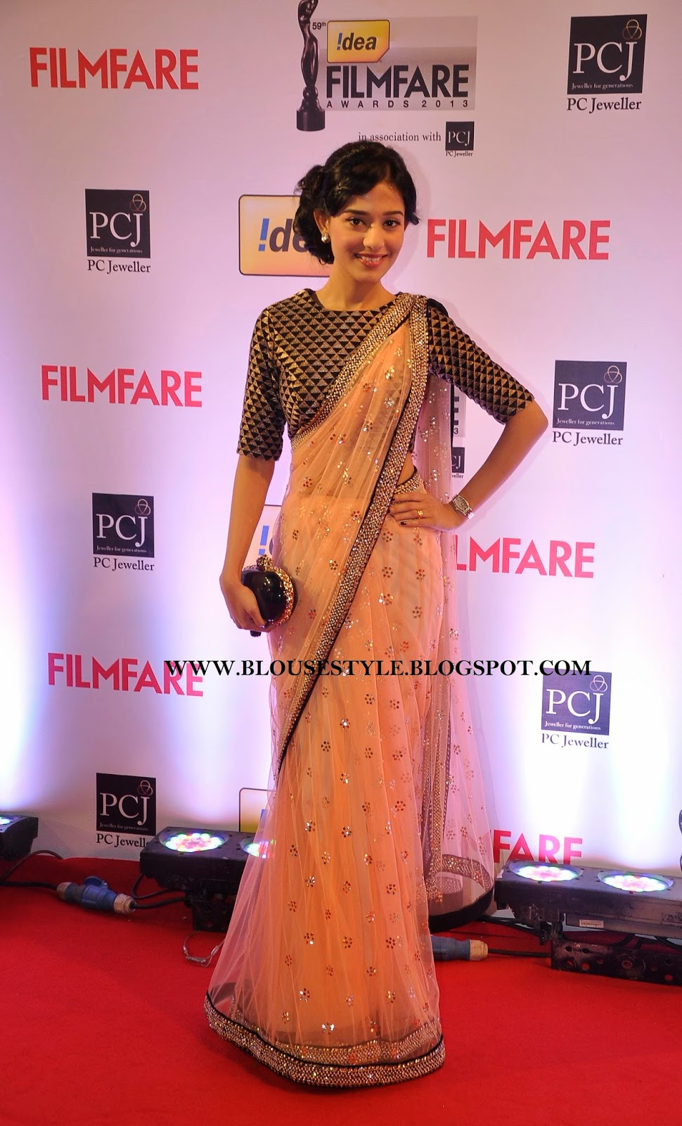 Bollywood actress in NET SAREE WITH BLACK WITH GOLD BLOUSE