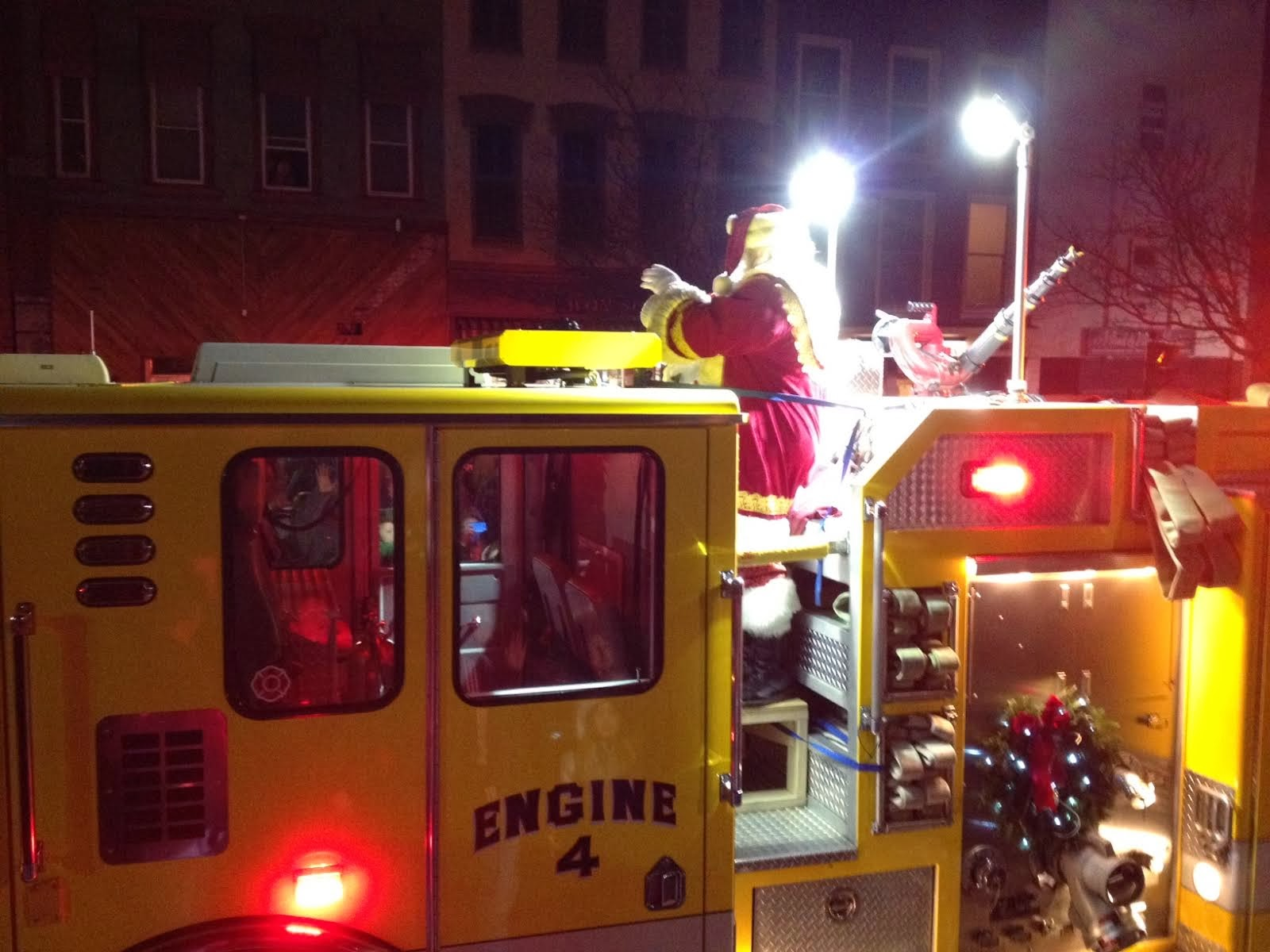 Firemen Bring Santa to the Kids
