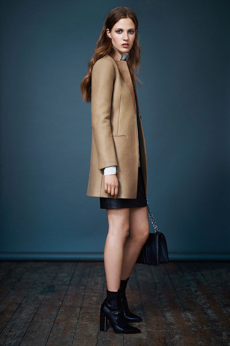 all saints aw october lookbook 2014. camel coat. leather skirt. heel boots. chain strap bag.