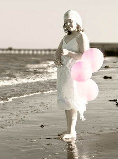 Girl with Pink Balloons on the Beach - has Down Syndrome