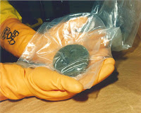 Plutonium held in hands of a nuclear worker