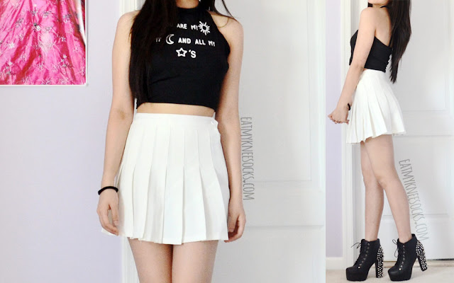 A grunge-rock monochromatic outfit featuring Dresslink's halter tie-back crop top, a white pleated American Apparel tennis skirt, and spiked Jeffrey Campbell Lita dupe platform booties.