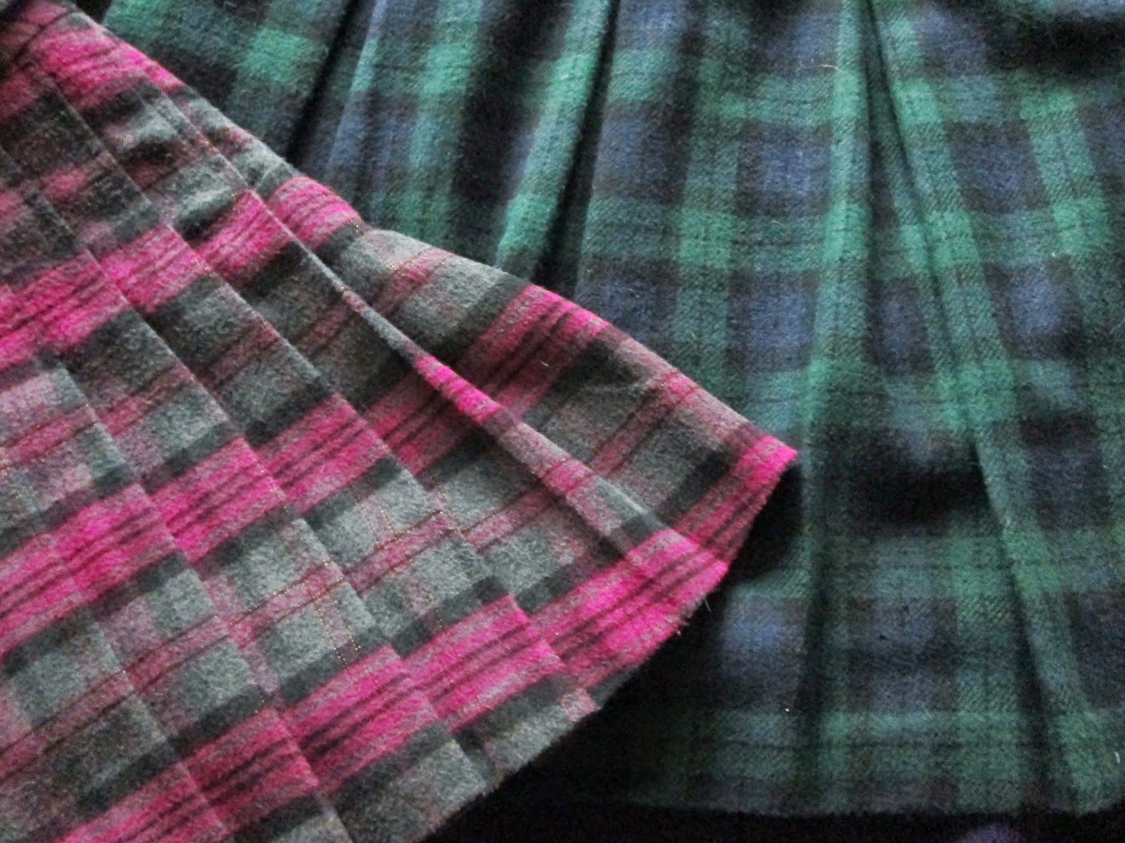 Pink kilt style mini skirt and green and blue tartan mini skirt