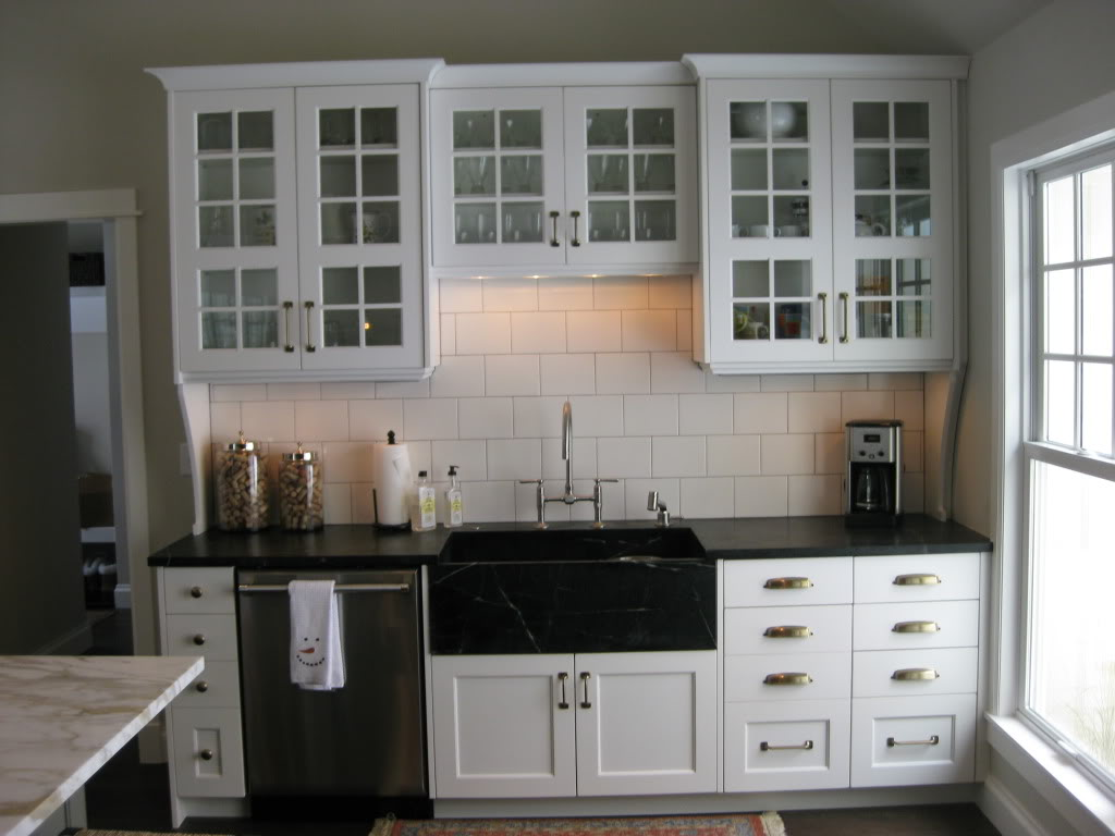 Black Kitchen Cabinets with White Subway Tile Backsplash
