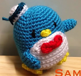 http://www.ravelry.com/patterns/library/crochet-penguin-sam-and-amy-doll-toy