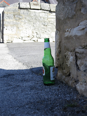 Bottle by wall