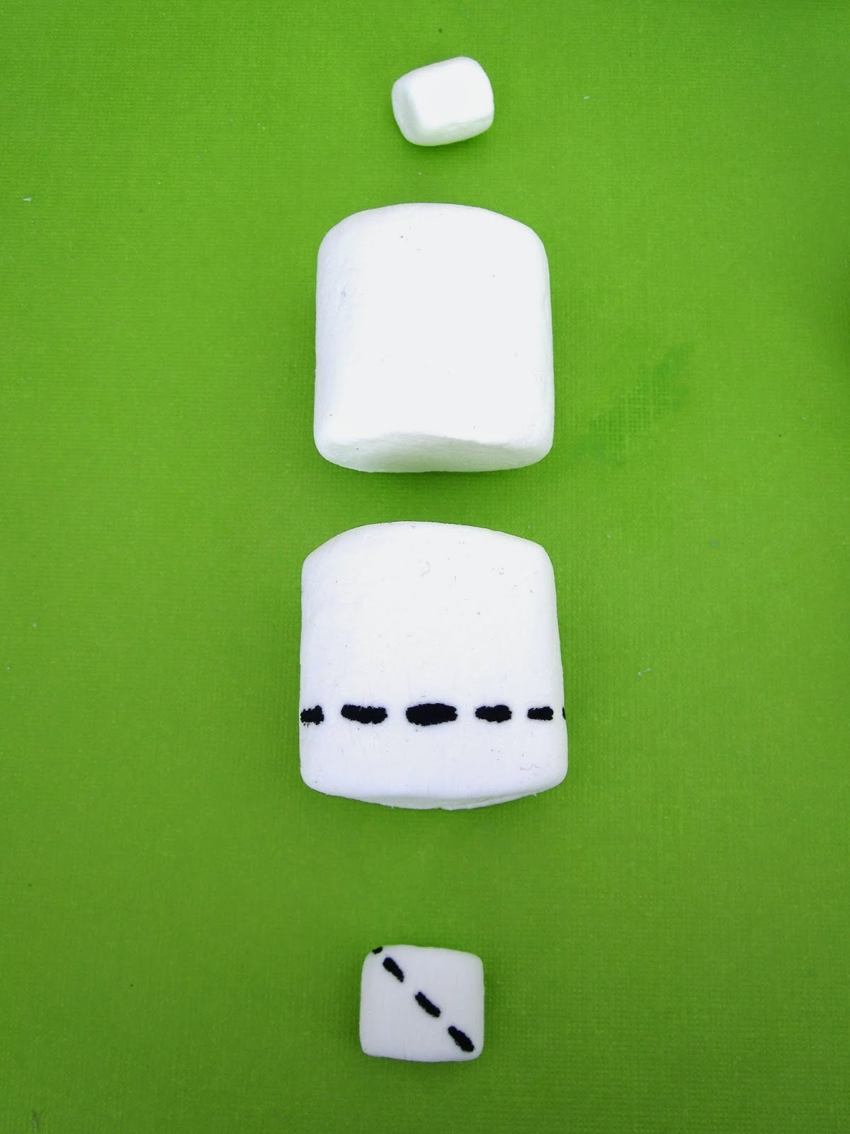 Roll The Cut Edges Of The Mini Marshmallow In Any Color Sugar Sprinkles  Cut Or Rip A Cross Cross In The Top Of The Second Mini Marshmallow To Create  A