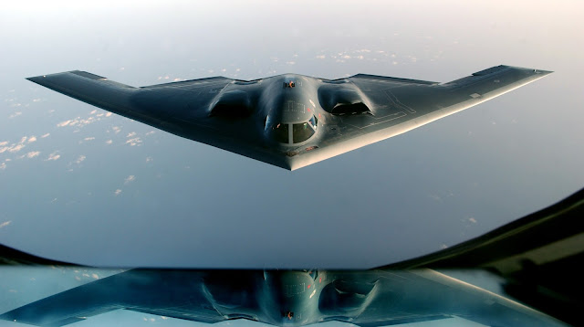 A B-2 Spirit, returning from a mission over Iraq, takes on fuel from a KC-135 Stratotanker