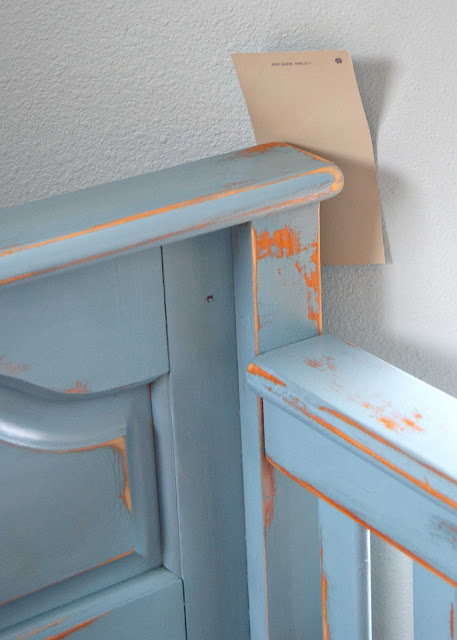 Close up of crib makeover with distressed finish