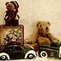 Old toy cars and teddy bears.