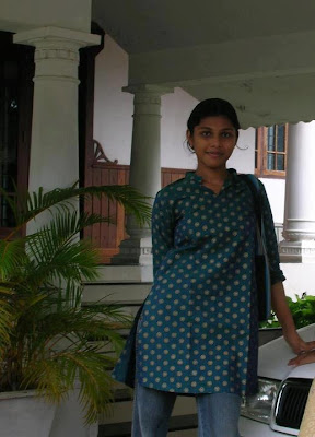 Tamil Nadu girl wearing long tops and jeans and she works at a software company.