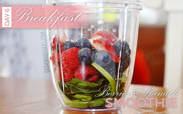 An unblended smoothie of blueberries, strawberries, raspberries, and spinach for a detox breakfast.
