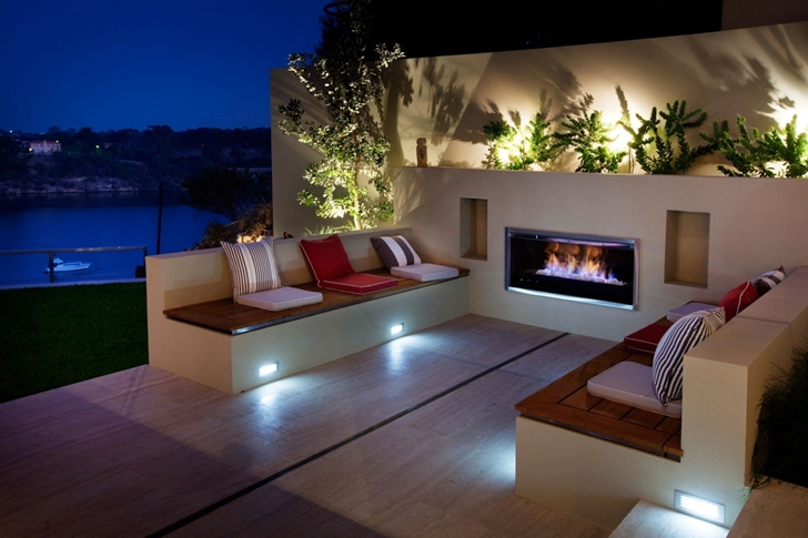 Outdoor fireplace in Modern backyard by Ritz Exterior Design