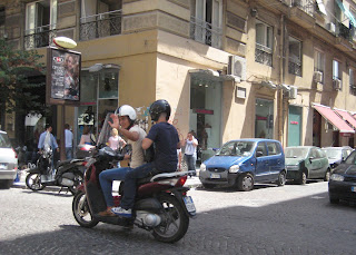 Friendly Italians on a motorcycle.