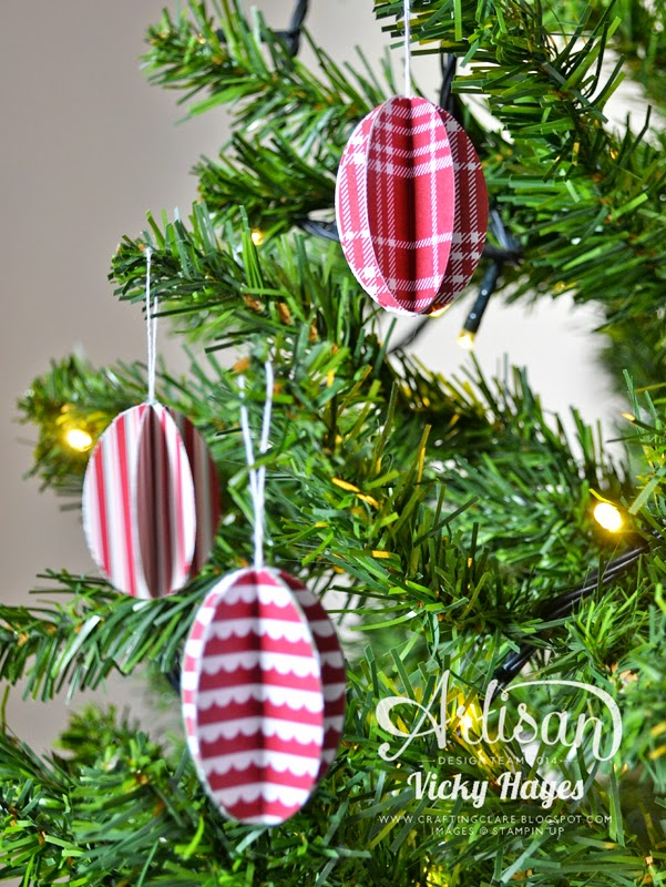 Handmade Christmas decorations using designer paper and a punch!