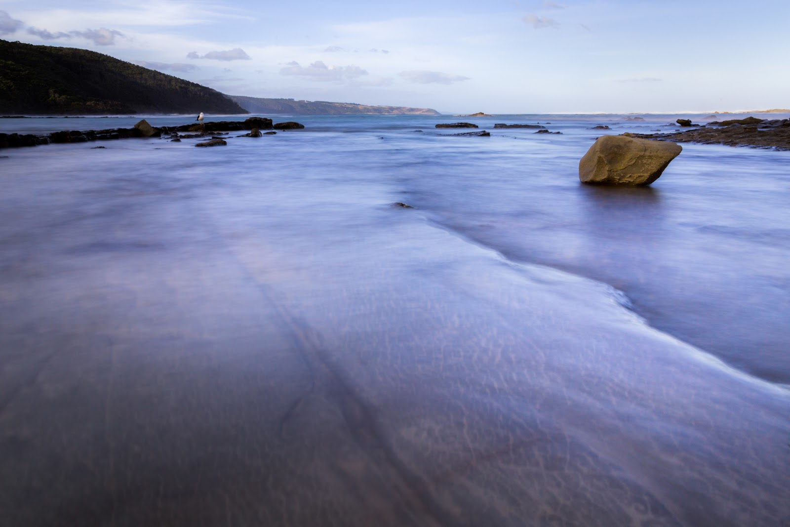 long exposure of water on rock shelf blanket bay
