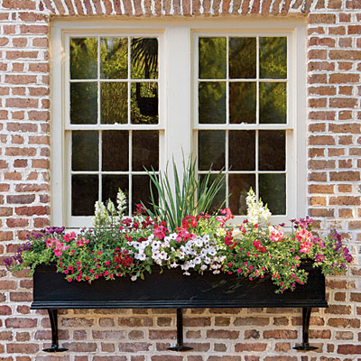 Window Boxes Abloom on Miniature Garden House With Porch