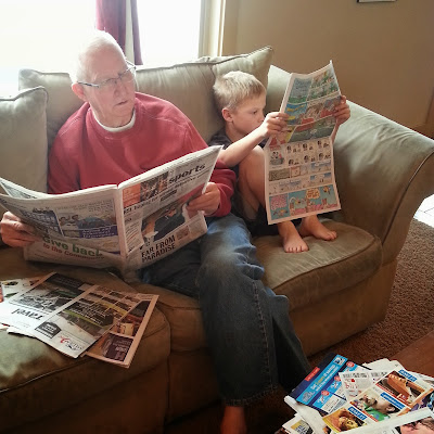Grandpa and Grandson reading the paper