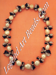 A similar necklace made with baroque pearls replacing the turquoise.