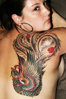 Cool Phoenix Tattoos On Women Picture 7