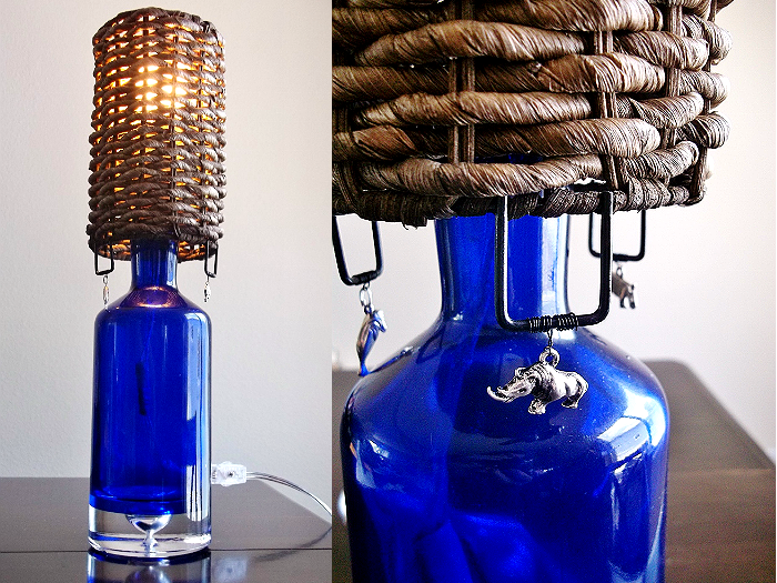 Blue glass upcycled bottle lamp made from an old liqour bottle. Safari style.