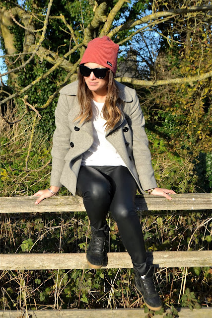 leather trousers and wool coat