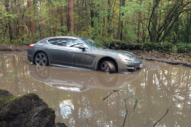Andre Wisdom drove this Porsche Panamera into a muddy pit