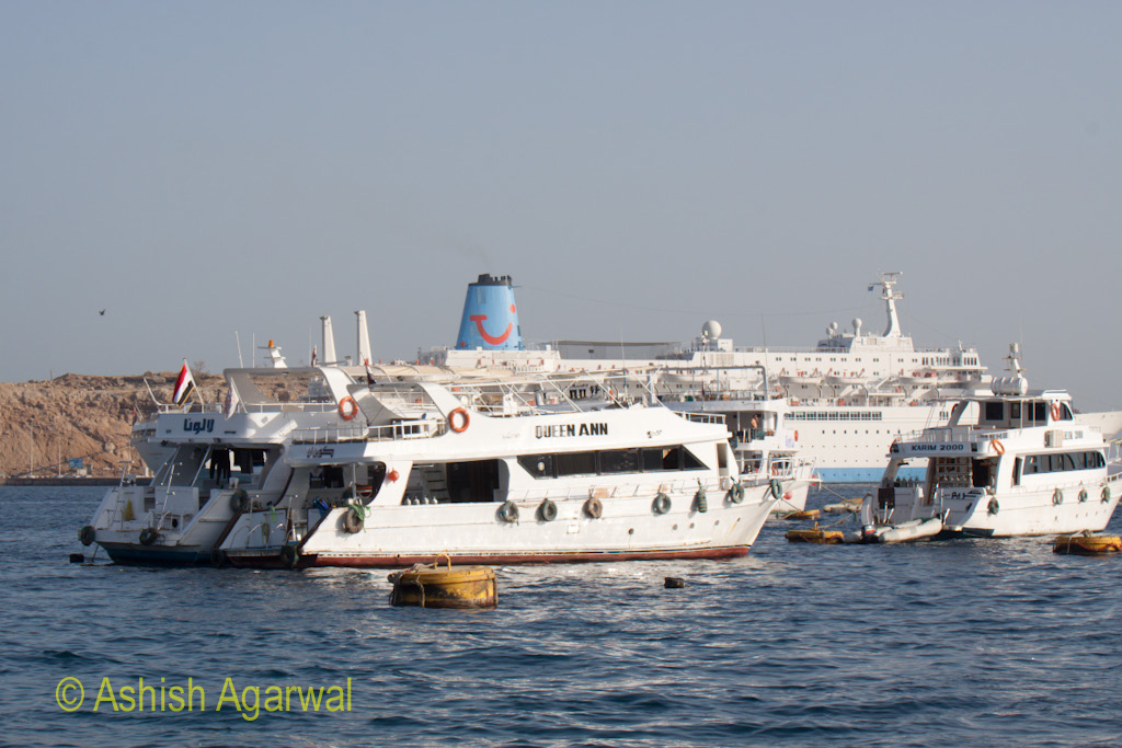 Multiple ships, including small ones and a large cruise liner in the Red Sea off Sharm el Sheikh