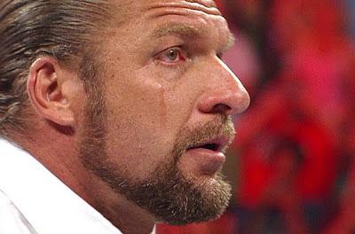 صور أشهر دموع المصارعين في WWE HHH-crying-triple-h-32060730-653-431
