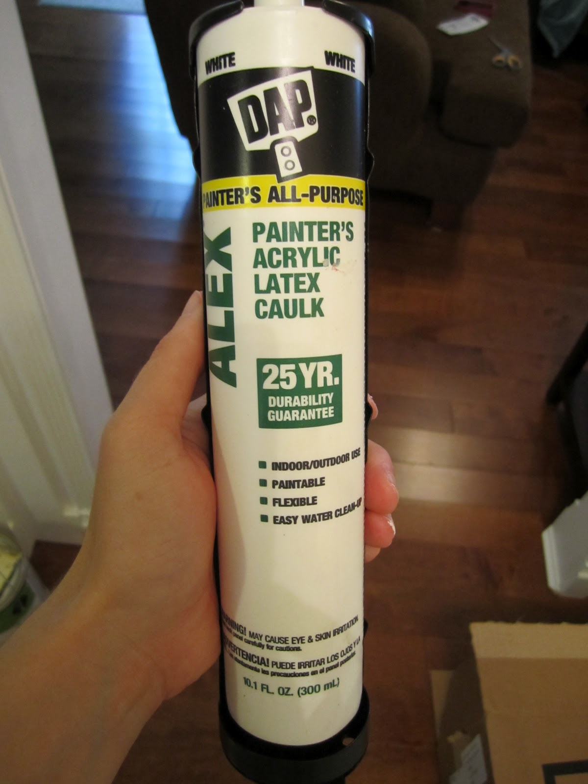how to get caulk out of tube