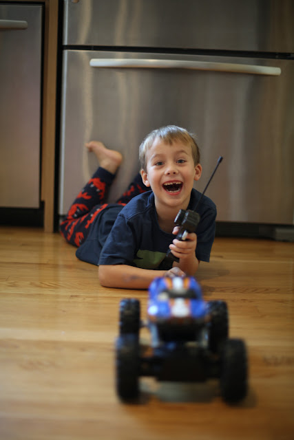 young boy playing with remote control truck