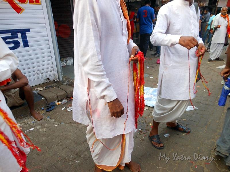 Red sacred threads at Lalbaugcha raja Pandal, Ganesh Pandal Hopping, Mumbai