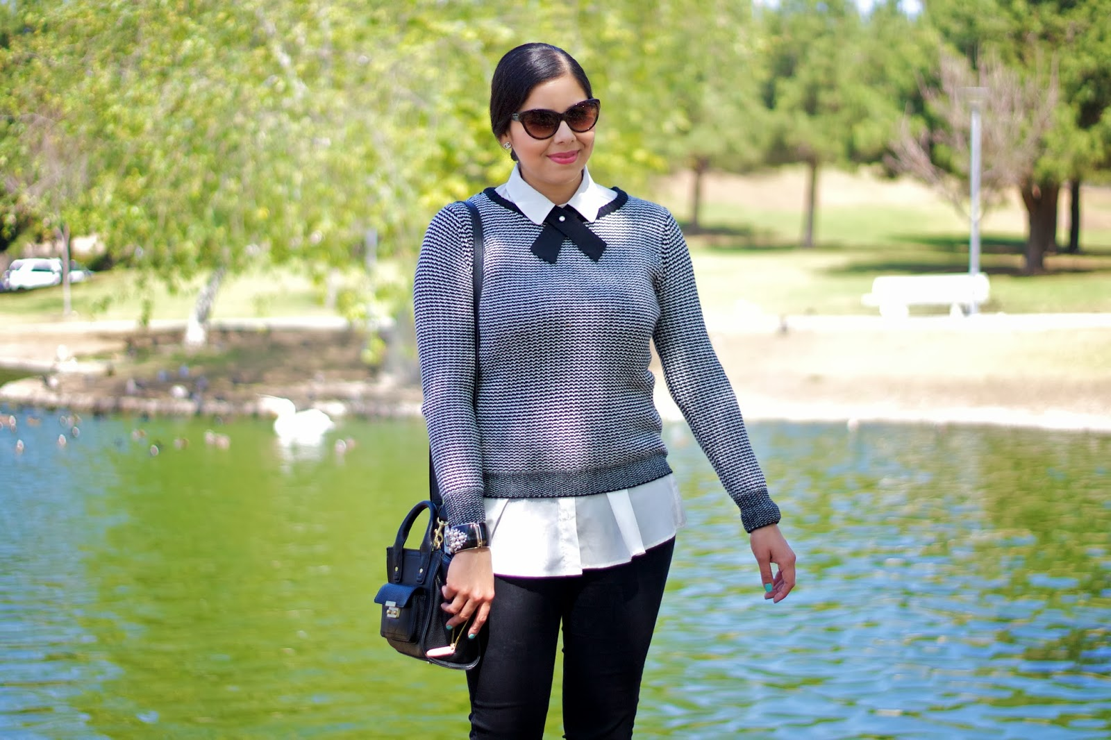 Collared shirt under sweater with bow tie