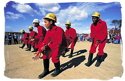 Gumboot dancing performed by mine workers