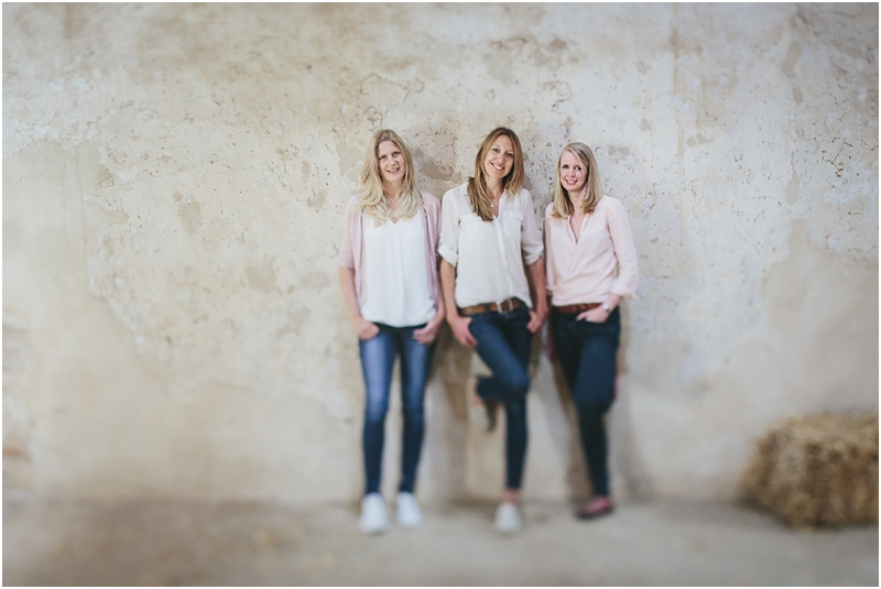 Amy, Jess and Caroline from Wire Creative, standing in a barn
